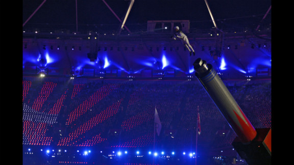 Chachi Valencia, alias The Rocket Man, is propelled in the air at the Olympic stadium.