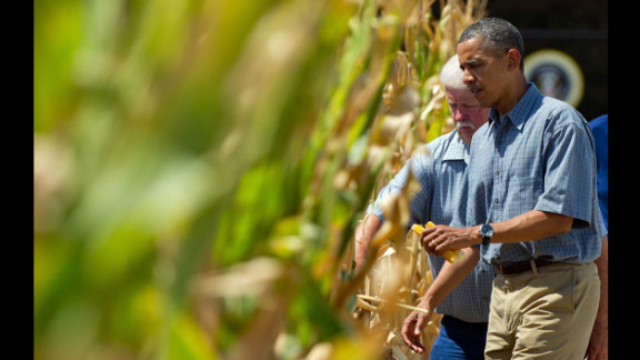 President Obama inspects a drought-stricken area of Missouri Valley, Iowa, with corn farmer Roger McIntosh on August 13 as he campaigns in the area. Since mid-June, corn prices have risen about 60% because of declining crop yields.