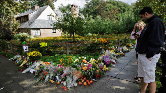 Mourners place flowers outside the Palo Alto, California, home of Apple co-founder Steve Jobs after his death last year.