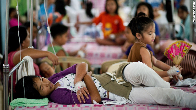 People with dengue disease rest on beds at the Quirino hospital in Manila.
