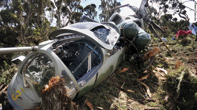 The Somalia-bound Ugandan helicopter is pictured at Mount Kenya on Monday, August 13, following its crash the day before.