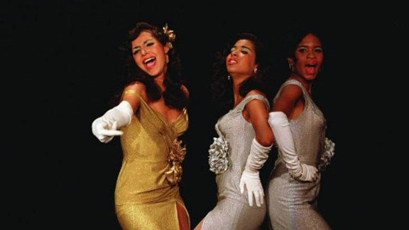 """""""Sparkle's"""" story follows the highs and lows of Williams siblings Sister, Sparkle and Delores, as their singing group starts to find success. Even for moviegoers who've never seen the original, R&B classics like """"Something He Can Feel,"""" performed fantastically in the film, will likely be familiar."""