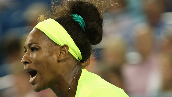 In a neon yellow outfit, Serena celebrates against Eleni Daniilidou of Greece during the 2012 Western & Southern Open in Mason, Ohio.