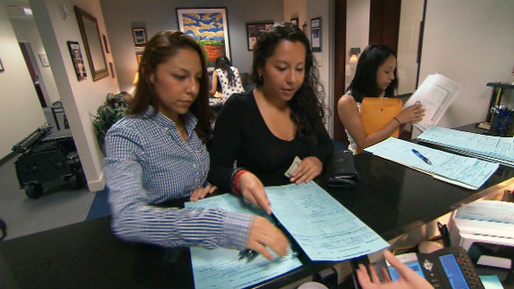 Sisters Ana and Juana Ramirez complete  deferred deportation applications.