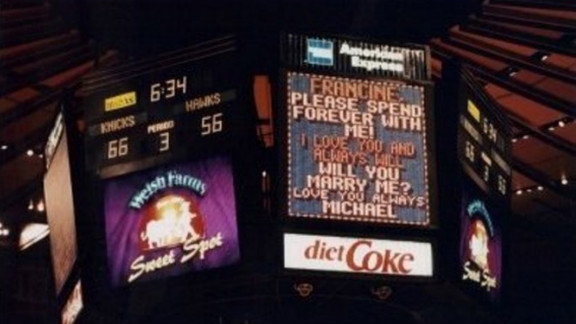 """When her boyfriend pointed to the JumboTron at a New York Knicks game, Francine Miraglia was slow to catch on to the public proposal. """"I actually read it and said,"""