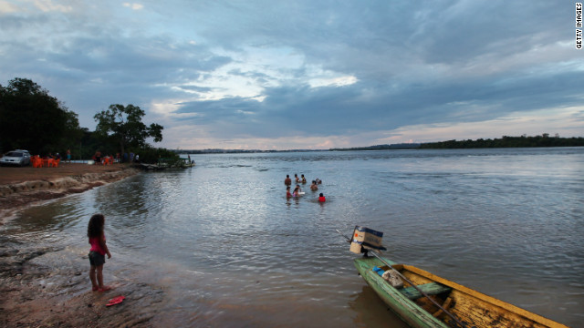 Brazilians bathe in the river near the area where the Belo Monte dam complex has been under construction.