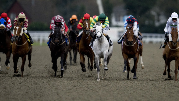 Sakhee Pearl, ridden by Ian Mongan, claims victory in a handicap race at England's Kempton Park racecourse in 2011.