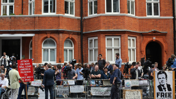 Media gather outside the Ecuadorian Embassy in London after Thursday