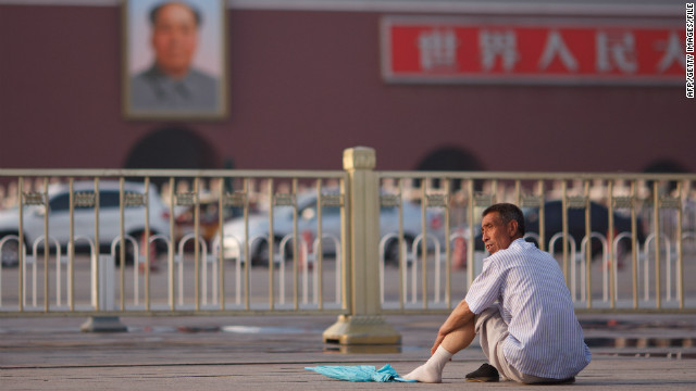 A portrait of late leader Mao Zedong overlooks Tiananmen Square in Beijing, where new leaders will be determined this year.