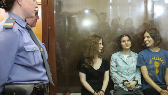 Members of the all-girl punk band 'Pussy Riot'  sit in a glass-walled cage after being sentenced in Moscow on Friday.
