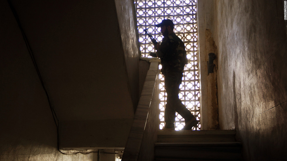 A rebel climbs some stairs in a building during clashes in central Aleppo's Salaheddine neighborhood.