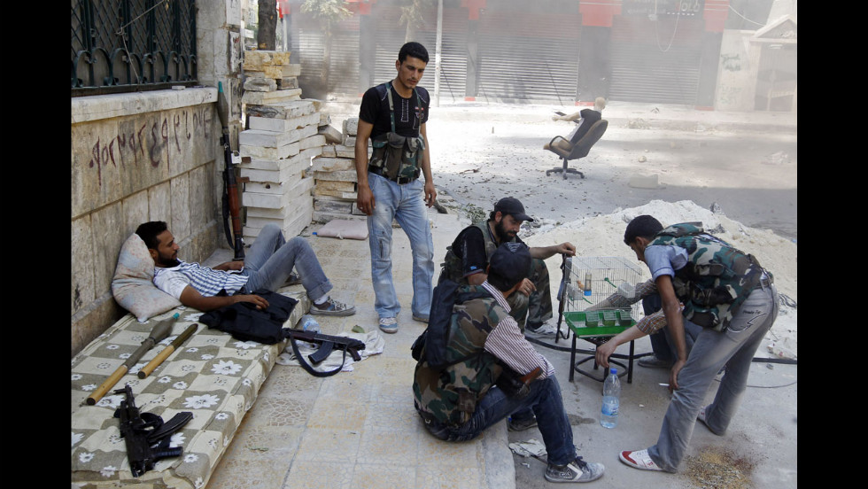 Free Syrian Army fighters rest Friday in Aleppo during a lull in fighting.
