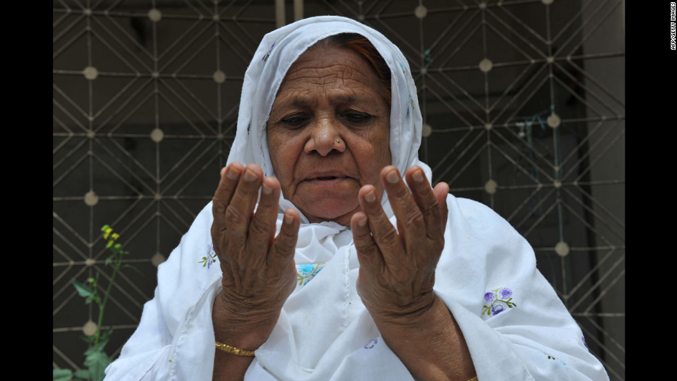 An Indian Muslim woman prays  outside the historic Mecca Masjid in Hyderabad.
