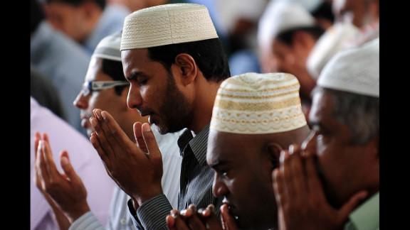 Sri Lankan Muslims take part in communal Friday noon prayers in Colombo.