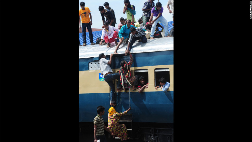 People cram onto a train as they rush home to be with their families in remote villages for Eid al-Fitr, in Dhaka, Bangladesh.