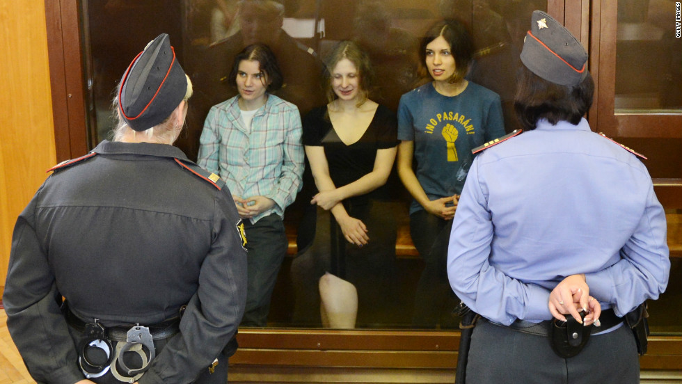 Pussy Riot band members Yekaterina Samutsevich, Maria Alyokhina and Nadezhda Tolokonnikova sit in a glass-walled cage during a court hearing in Moscow on Friday August 17.