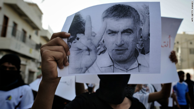 A Bahraini Shiite Muslim youth holds a picture of prominent rights activist Nabeel Rajab during a demonstration on June 11.