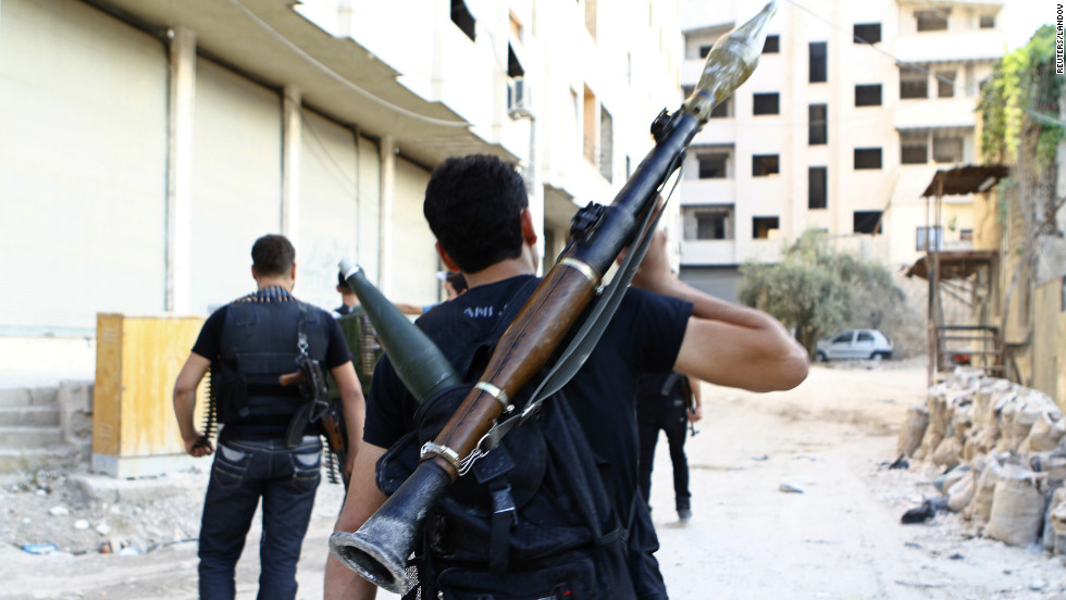 A rebel holds a rocket-propelled grenade Friday in the Damascus suburb.