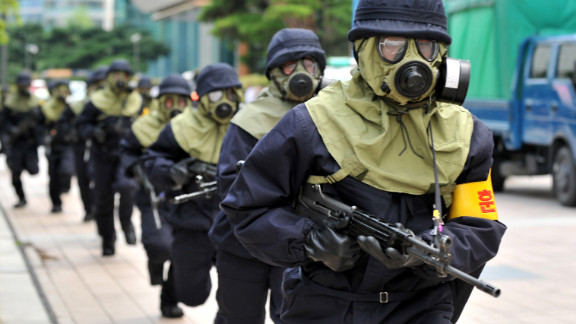 South Korean police in gas masks take part in a drill Saturday in Seoul as part of joint U.S.-South Korean military exercises.