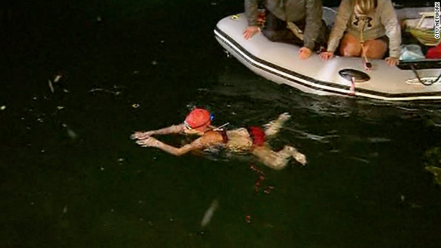 Annaleise Carr, 14, finishes a 31.6-mile solo swim across Lake Ontario just before 9 p.m. on Sunday.