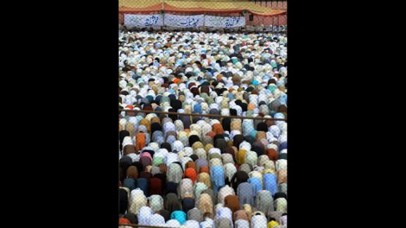 Pakistani Muslims offer Eid al-Fitr prayers in Karachi on Monday.