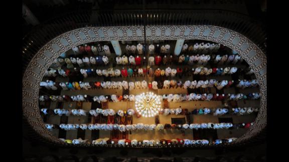 Bangladeshi Muslims offer Eid al-Fitr prayers at the National Mosque of Bangladesh, Baitul Mukarram in Dhaka on Monday.