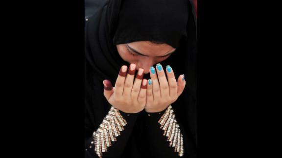 A Pakistani Muslim devotee offers Eid al-Fitr prayers at the Badshahi Masjid Mosque on Monday.