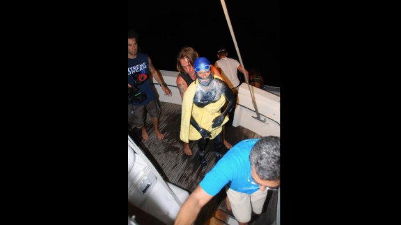 Endurance swimmer Diana Nyad's latest attempt to swim across the Straits of Florida ended Tuesday morning after severe jellyfish stings and a lightning storm put her off course, her team said.