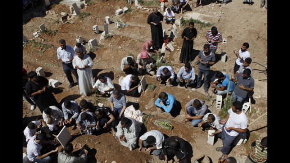 People pray during the funeral of a Free Syrian Army fighter, Amar Ali Amero, on August 21, 2012.