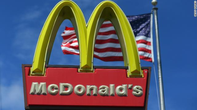An American flag flies behind a McDonald's restaurant sign in Miami.