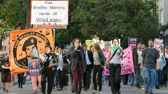 Protesters march toward the Obama campaign headquarters Thursday to demand Bradley Manning