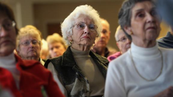 """Seniors attend a """"Medicare Monday"""" seminar in Colorado. Amitai Etzioni says curbing health care costs will curb Medicare costs."""