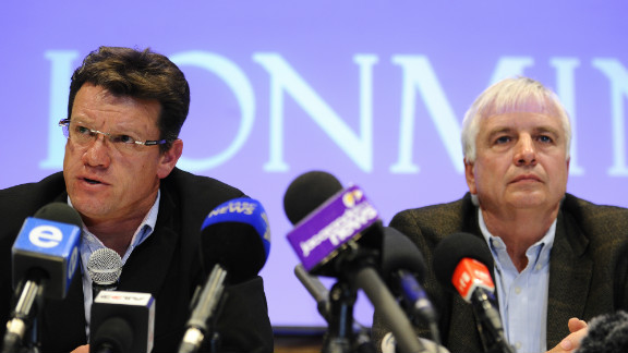 Mark Munroe (left), executive vice president for mining at Lonmin, sits alongside the company's chief financial officer Simon Scott during a press conference  in Marikana on August 20.
