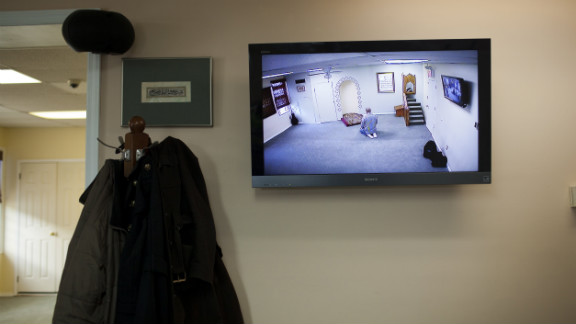 A CCTV monitor displays a man praying February 25 at the Iqra Masjid in Brooklyn, New York.