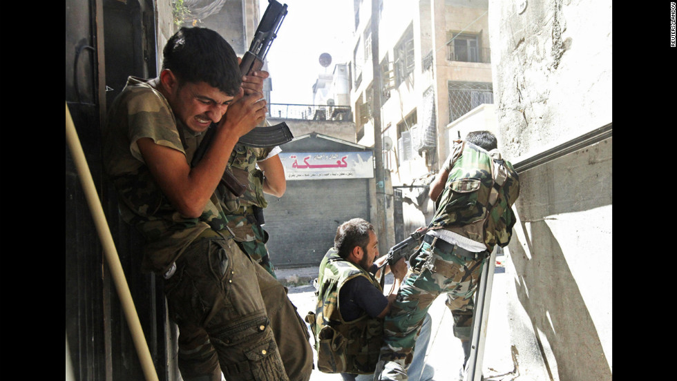 Members of the Free Syrian Army clash with Syrian army soldiers in Aleppo's Saif al-Dawla district on August 22.