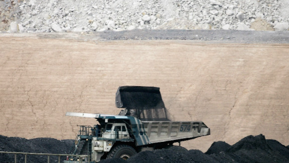 A coal truck is loaded at BHP Billiton