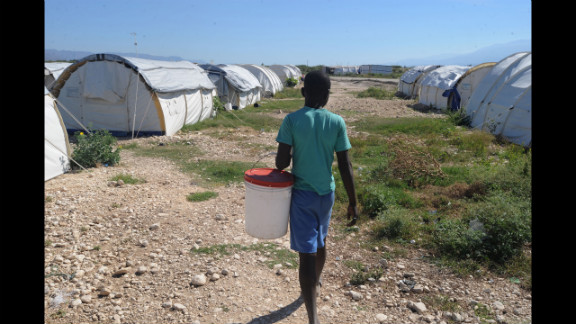A young Haitian walks by dwellings being built by World Vision and UNICEF for the victims of the earthquake on January 4, 2011.