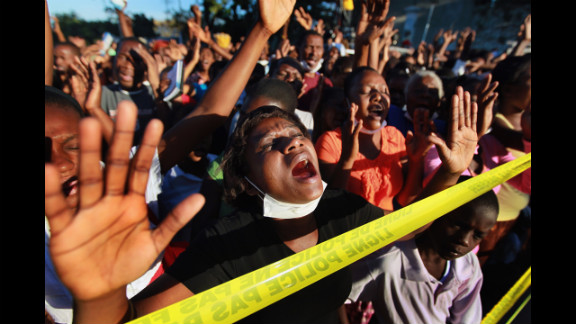 People in Port-au-Prince attend a prayer service held on January 12, 2011, in memory of those killed a year earlier during the earthquake.