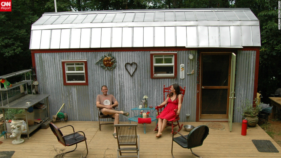 "Downsizing from a 1,500-square-foot house to a tiny 168-square-foot dwelling in Floyd, Virginia, Hari Berzins says she loves the freedom when it comes to tiny living. ""We live larger on our 3-acre hillside,"" she said. ""We have more time to enjoy each other, tend to our large garden and cultivate a supportive community.""<a href=""http://ireport.cnn.com/docs/DOC-817695"" target=""_blank"">See more photos of their charming home on Hari Berzin's iReport</a>."