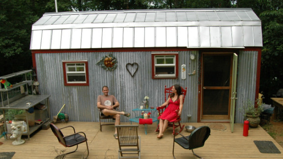 "Downsizing from a 1,500-square-foot house to a tiny 168-square-foot dwelling in Floyd, Virginia, Hari Berzins says she loves the freedom when it comes to tiny living. ""We live larger on our 3-acre hillside,"" she said. ""We have more time to enjoy each other, tend to our large garden and cultivate a supportive community."""