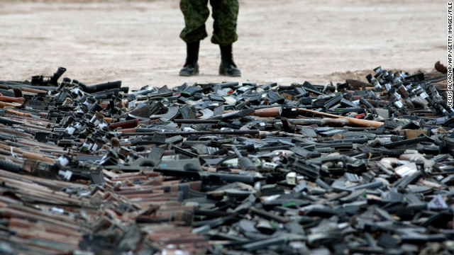 Thousands of guns lie on the ground before their destruction in Ciudad Juarez, Chihuahua State, Mexico on February 16, 2012. At least 6000 rifles and pistols seized to drugs cartels were destroyed by members of the Mexican Army. AFP PHOTO/JESUS ALCAZAR (Photo credit should read Jesus Alcazar/AFP/Getty Images)