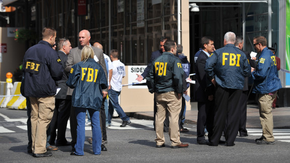FBI agents gather at the scene, which some witnesses said sparked memories of the 2001 terrorist attacks. Authorities said the shooting was not related to terrorism.