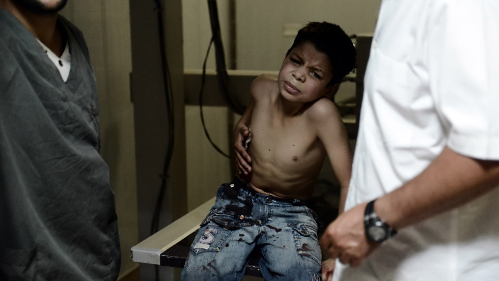 A boy receives treatment for wounds he received during an airstrike by a regime forces helicopter in Syria's northern city of Aleppo on Friday, August 24. Government forces blitzed areas in and around Syria's largest city, activists said, as Western powers sought to tighten the the reins on embattled President Bashar al-Assad's regime.