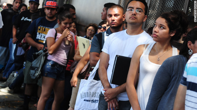 Undocumented immigrants line up to apply for the deferred deportation program this month in Los Angeles.