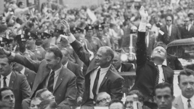Apollo 11 astronauts Neil Armstrong, Buzz Aldrin and Michael Collins addressing the crowd at a parade celebrating their return from the moon.