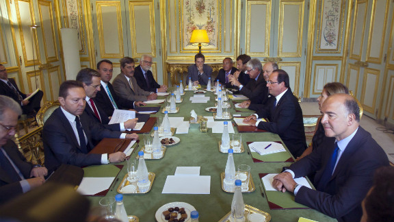 Francois Hollande (3rd right) meets Greek PM Antonis Samaras (3rd left) in Paris on Saturday.