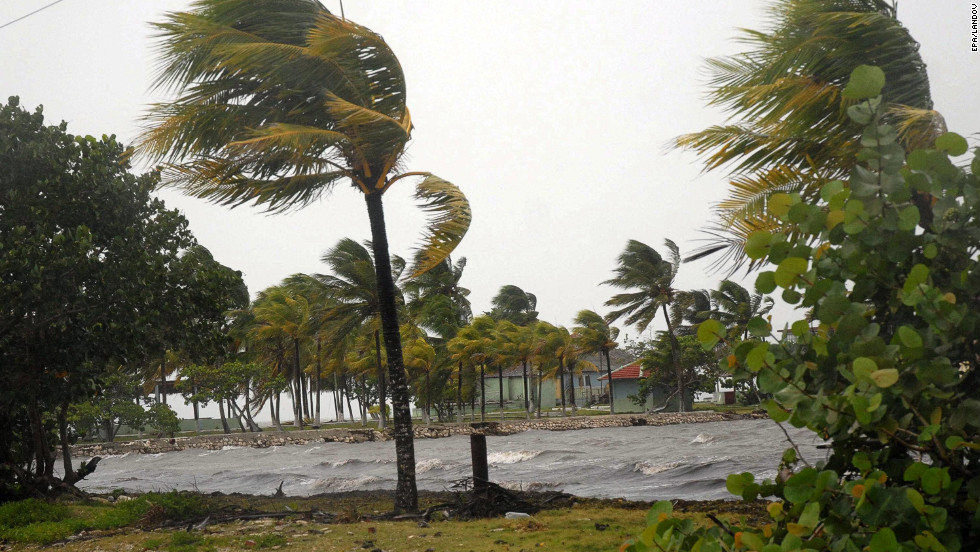 Strong winds bend palm trees in Cuba's northern province of Sancti Spiritus on Saturday. Isaac is expected to strengthen and become a Category 1 hurricane by early Monday as it draws nearer to Florida.