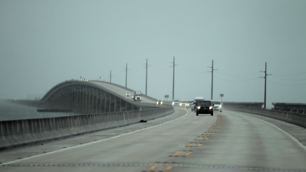Vehicles cross a bridge leaving the Lower Keys on Saturday as the storm strengthens and moves closer.