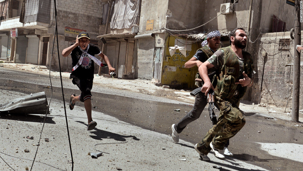 Rebel fighters run for cover during continued clashes with government forces in Aleppo on Saturday, August 25.