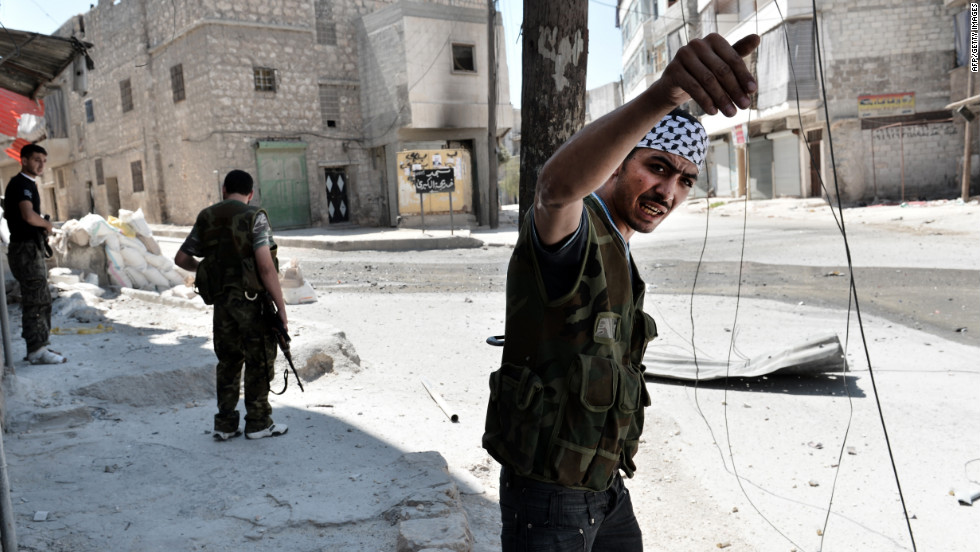 A rebel fighter communicates to his commanders during ongoing fighting in Aleppo's Mashhad neighborhood.